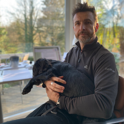 Matt Button with his dog, Badger